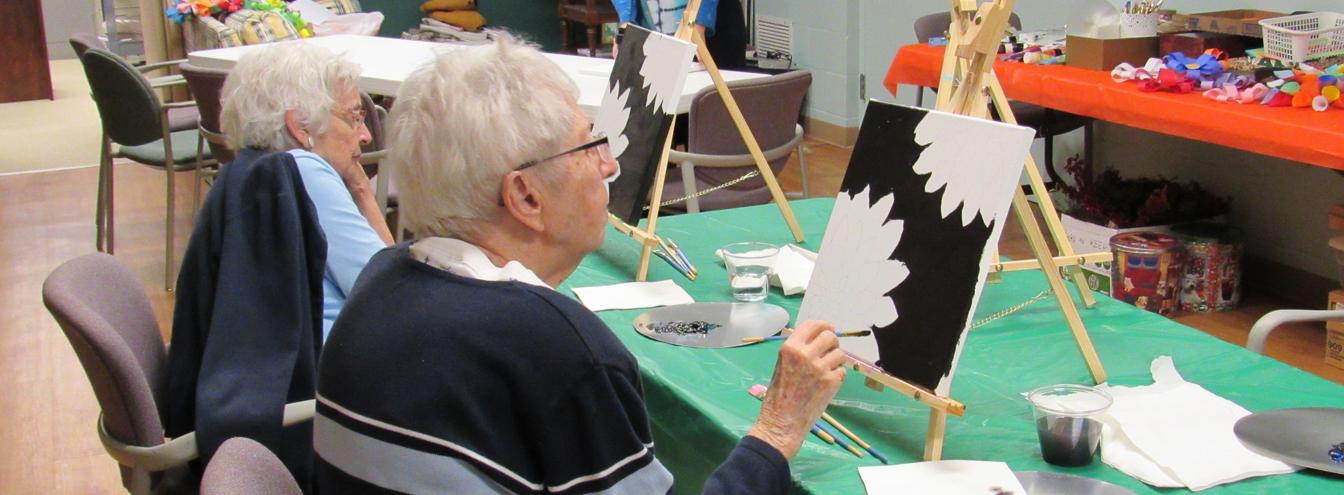 Women Painting Flowers