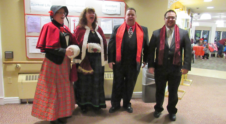 Carolers Roam Our Mall and Halls